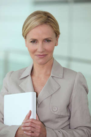 front office: Businesswoman holding laptop