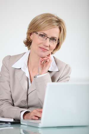 Woman in glasses at laptop computer photo