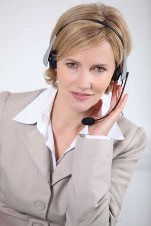 mobile voip: Smart woman wearing a telecommunications headset Stock Photo