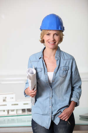 35 39 years: Woman in hard hat with architect Stock Photo