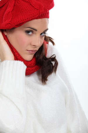 poker faced: Woman wearing warm clothing Stock Photo