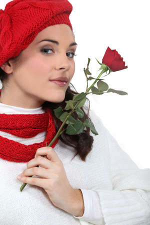 A woman with a rose  photo
