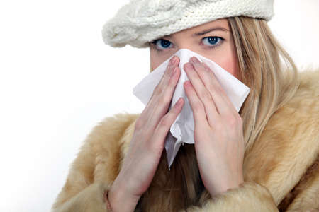 Woman blowing her nose Stock Photo - 15916139