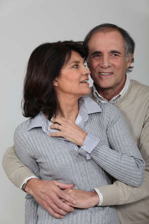 A middle age couple hugging  photo