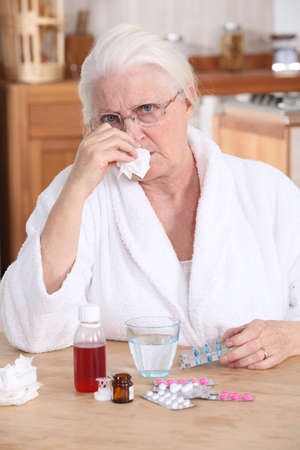 65 70 years: grandmother having a cold