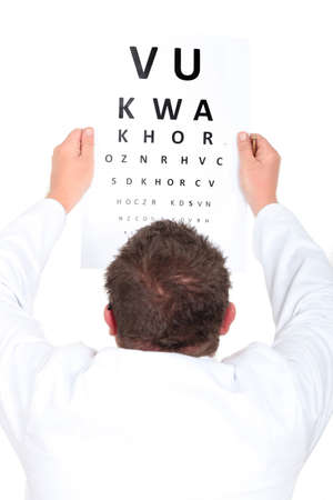 Optician holding up an eyechart photo