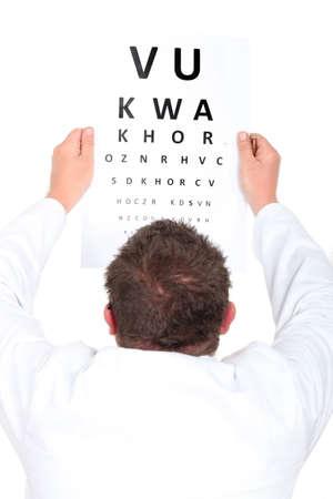 test paper: Optician holding up an eyechart