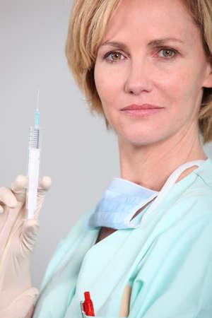 surgical needle: nurse preparing an injection Stock Photo