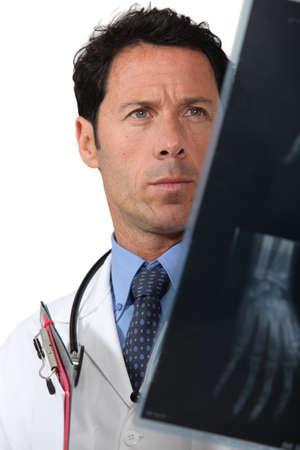 Doctor examining x rays photo