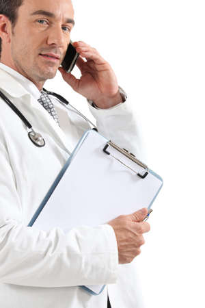 Doctor on phone with clipboard photo