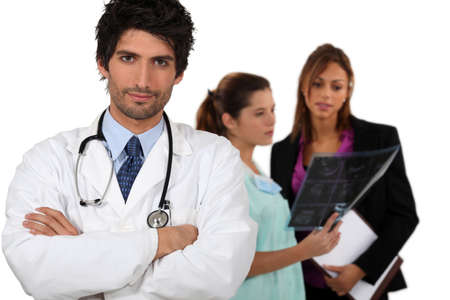 Doctor with medical staff in the background photo