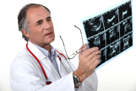 oncologist: Doctor examining a scan