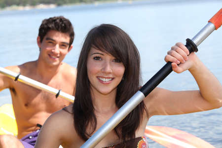 Young couple in a canoe photo