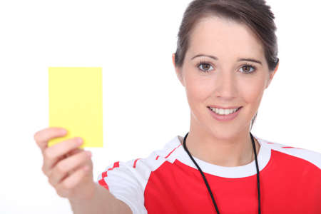 Referee holding up a yellow card Stock Photo - 15915792