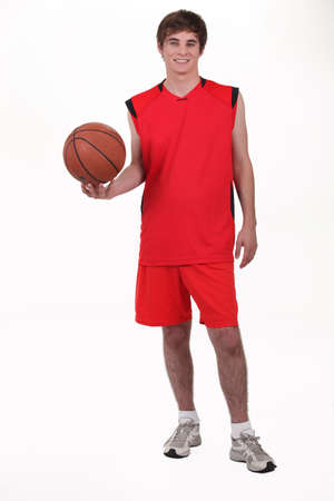 Studio portrait of a basketball player wearing a red kit photo