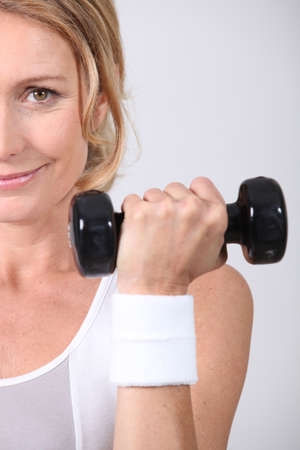 30 35 years women: Closeup of woman with dumbbell