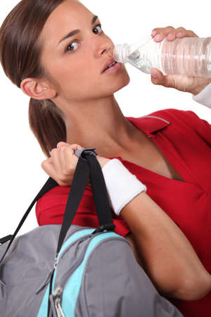 long neck: Athlete drinking water Stock Photo