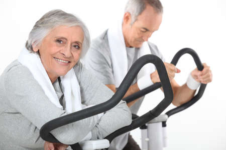 A mature couple exercising  photo