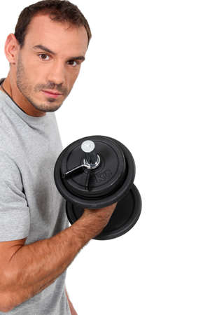 pumping: man training with a dumbbell