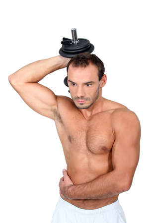 robustness: young man with dumbell