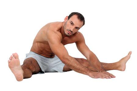 naked male body: half naked man doing exercises