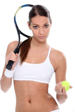 belly button: Mujer joven listo para el tenis Foto de archivo