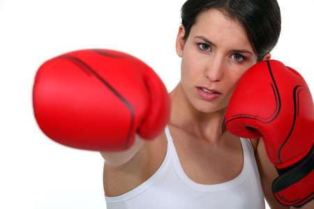 adversaries: Woman with boxing gloves