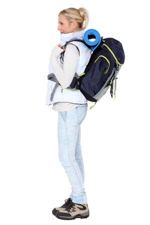 female backpacker in profile photo