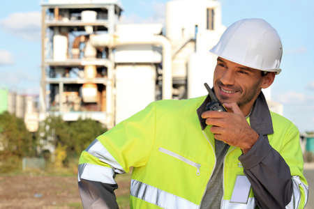 walkie: Site foreman communicating via radio receiver Stock Photo