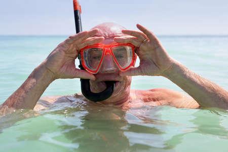 Older man snorkelling photo