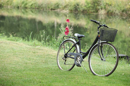 Bike placed in grass at the riverside