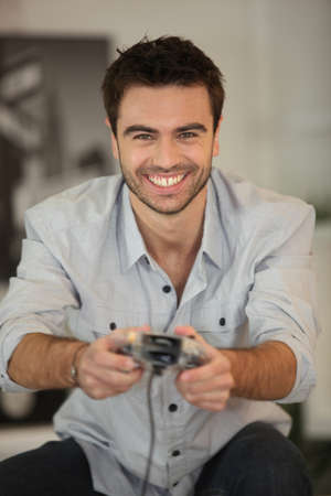 young man portrait: Smiling man playing games