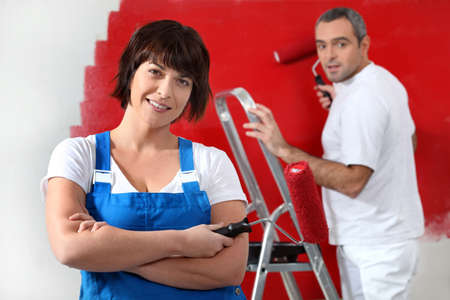 average guy: Couple painting wall in red
