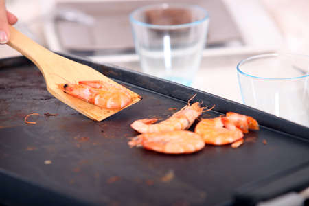convivial: Cooking seafood on a plancha Stock Photo