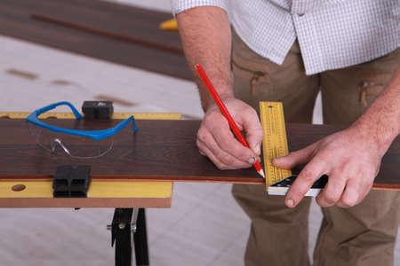 Man marking-off laminate flooring Stock Photo - 15967190