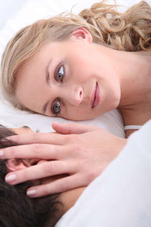 couple embracing in bed Stock Photo - 15967747