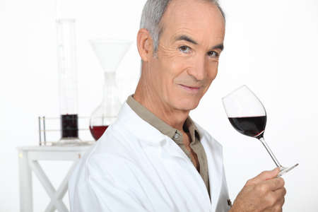 Oenologist analysing a wine photo