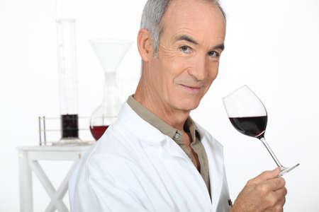 olfaction: Oenologist analysing a wine