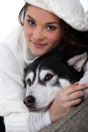 gray wolf black and white: Woman with her dog