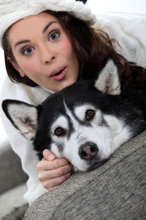 Woman with a dog on the sofa photo