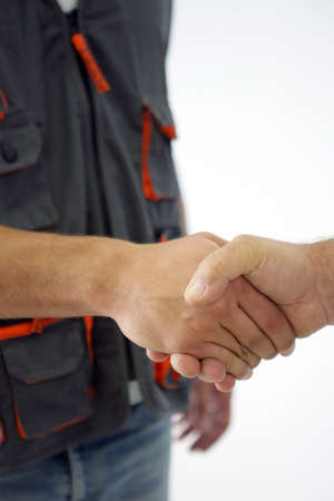 handshaking: Manual worker shaking hand