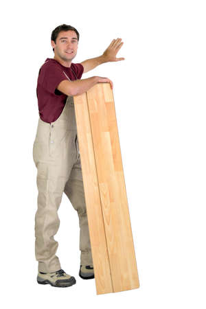 concealed: Worker holding planks of wood Stock Photo