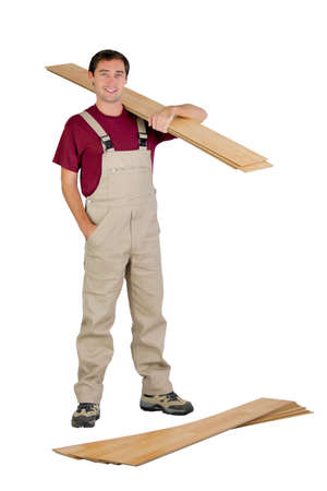 Man with a pile of flooring photo