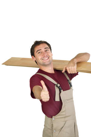 Elated carpenter giving the thumb Stock Photo - 16037803