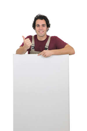 assent: Worker holding up a blank sign