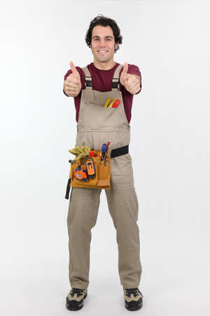 thumbsup: Young handyman thumbs-up gesture