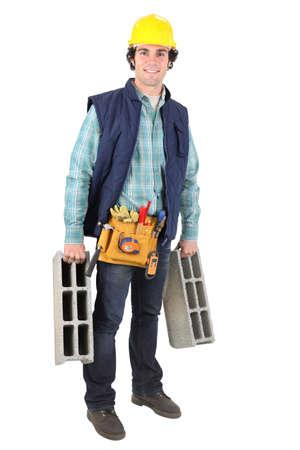 Man carrying breeze blocks photo