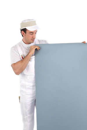 drop ceiling: Painter holding a board Stock Photo