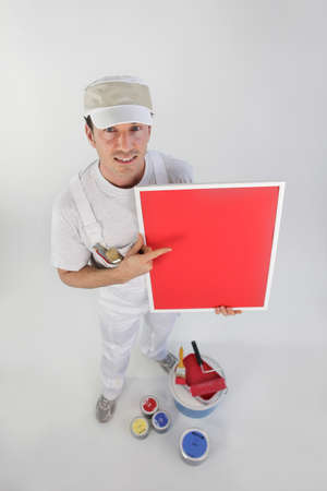 quickly: craftsman painter showing the quality of his paint Stock Photo