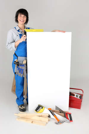 craftswoman: craftswoman taking measurements